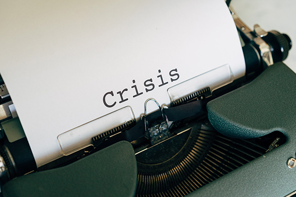 Crisis written on paper by typewriter