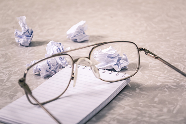 Crumpled papers and glasses