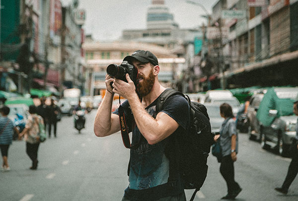 a photographer taking photos from city