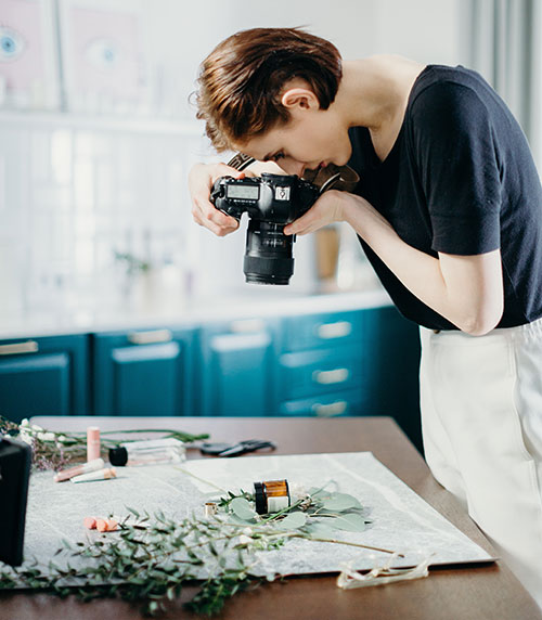 a woman taking photos from a product