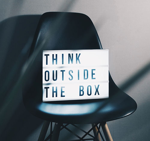 Think out of the box sign on a chair