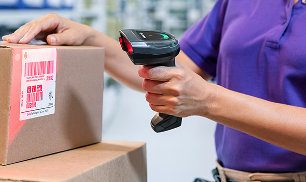 a person scanning the barcode of a product