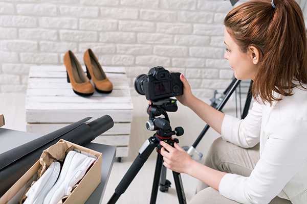 a Product Photographer taking photos of a pair of shoes