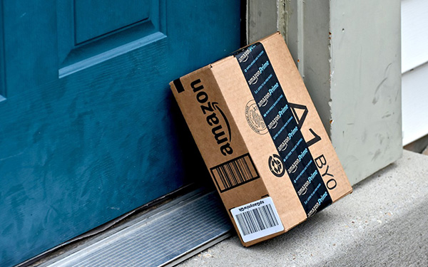 an amazon prime package leaning on the door