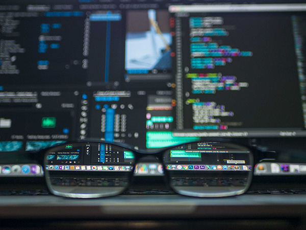programming and codes on screen through a pair of glasses
