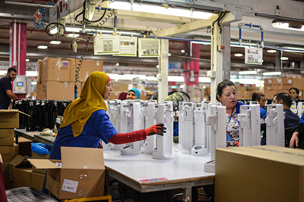Woman Workers in Factory Assembly Line